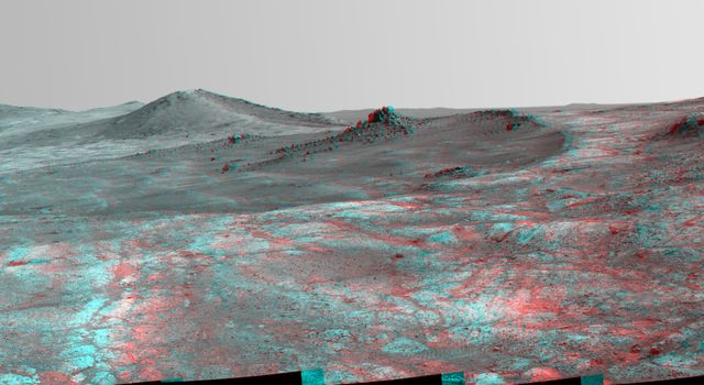 An elongated crater called 'Spirit of St. Louis,' with a rock spire in it, dominates this stereo view from the panoramic camera (Pancam) on NASA's Mars Exploration Rover Opportunity.