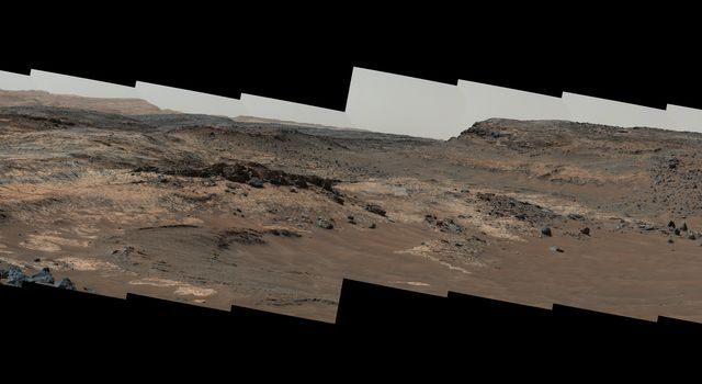A sweeping panorama combining 33 telephoto images into one Martian vista presents details of several types of terrain visible on Mount Sharp from a location along the route of NASA's Curiosity Mars rover.