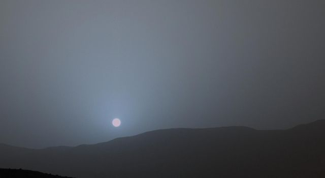 This frame is from sequence of views NASA's Curiosity Mars rover recorded of the sun setting at the close of the mission's 956th Martian day, or sol (April 15, 2015), from the rover's location in Gale Crater.