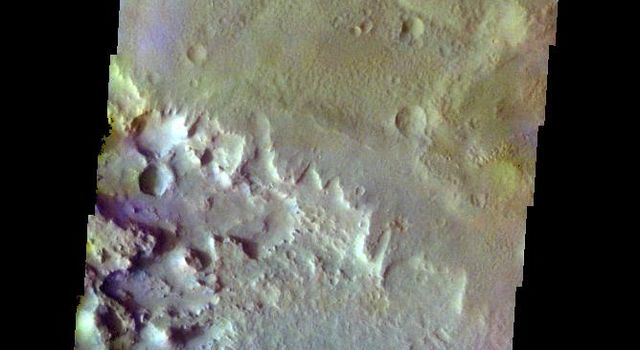 The THEMIS VIS camera contains 5 filters. The data from different filters can be combined in multiple ways to create a false color image. This false color image from NASA's 2001 Mars Odyssey spacecraft show part of the floor of Schaeberle Crater.