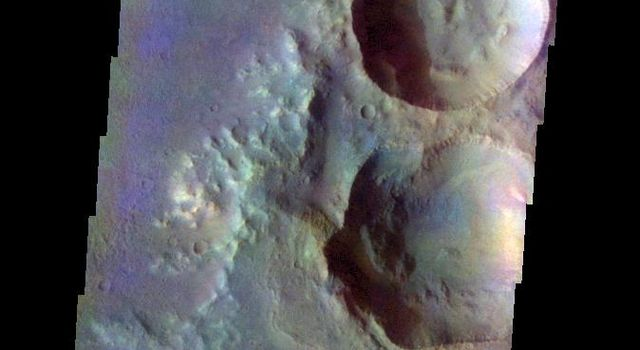 The THEMIS VIS camera contains 5 filters. The data from different filters can be combined in multiple ways to create a false color image. This false color image from NASA's 2001 Mars Odyssey spacecraft shows craters in Terra Cimmeria.