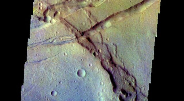 The THEMIS VIS camera contains 5 filters. The data from different filters can be combined in multiple ways to create a false color image. This false color image from NASA's 2001 Mars Odyssey spacecraft shows several linear depressions.