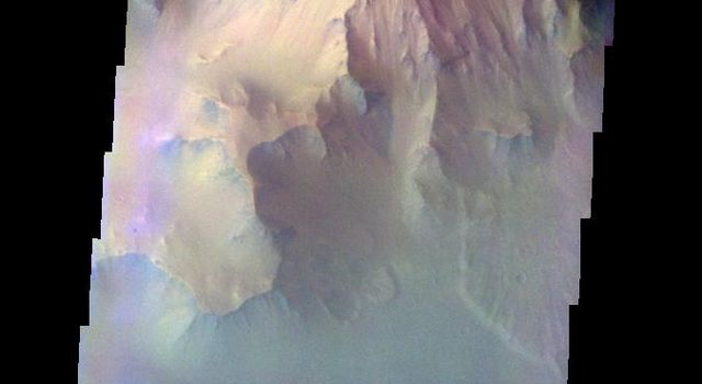 The THEMIS VIS camera contains 5 filters. The data from different filters can be combined in multiple ways to create a false color image. This image from NASA's 2001 Mars Odyssey spacecraft shows part of the northern cliff face of Ganges Chasma.