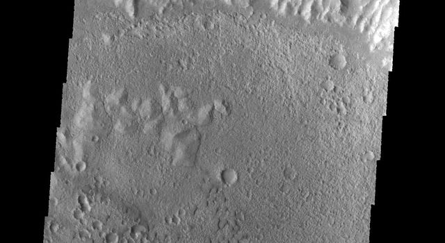 This image captured by NASA's 2001 Mars Odyssey spacecraft shows a region of small isolated dunes on the floor of an unnamed crater in Terra Cimmeria.