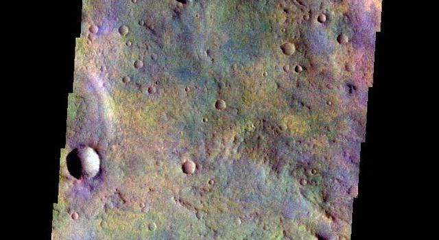 The THEMIS VIS camera contains 5 filters. The data from different filters can be combined in multiple ways to create a false color image. This false color image from NASA's 2001 Mars Odyssey spacecraft shows a portion of the plains in Terra Sabaea.