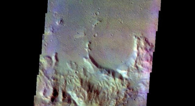 The THEMIS VIS camera contains 5 filters. Data from different filters can be combined in multiple ways to create a false color image. This image from NASA's 2001 Mars Odyssey spacecraft shows the floor and rim of an unnamed crater in Terra Cimmeria.
