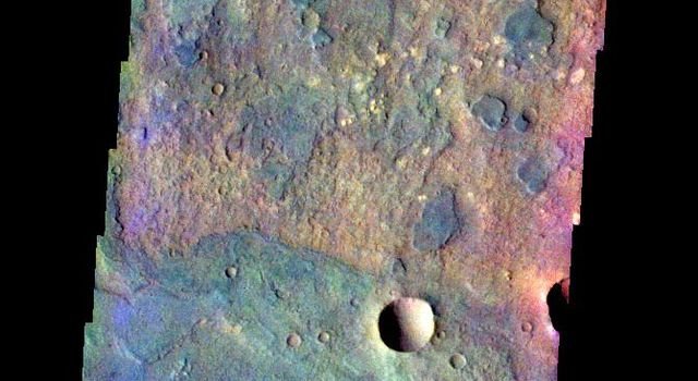 The THEMIS VIS camera contains 5 filters. The data from different filters can be combined in multiple ways to create a false color image. This image from NASA's 2001 Mars Odyssey spacecraft shows a small portion of the floor of Huygens Crater.