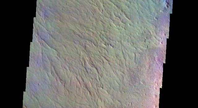 The THEMIS VIS camera contains 5 filters. The data from different filters can be combined in multiple ways to create a false color image. This false color image from NASA's 2001 Mars Odyssey spacecraft shows part of the rim and floor of Saheki Crater.