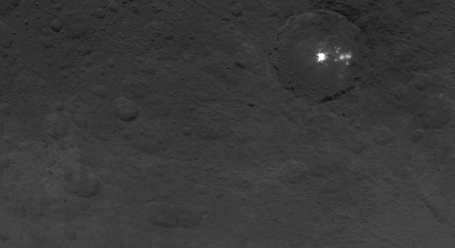 A cluster of mysterious bright spots on dwarf planet Ceres can be seen in this image, taken by NASA's Dawn spacecraft on June 9, 2015.