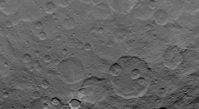 This image, taken by NASA's Dawn spacecraft, shows dwarf planet Ceres from an altitude of 2,700 miles (4,400 kilometers). The image, with a resolution of 1,400 feet (410 meters) per pixel, was taken on June 18, 2015.