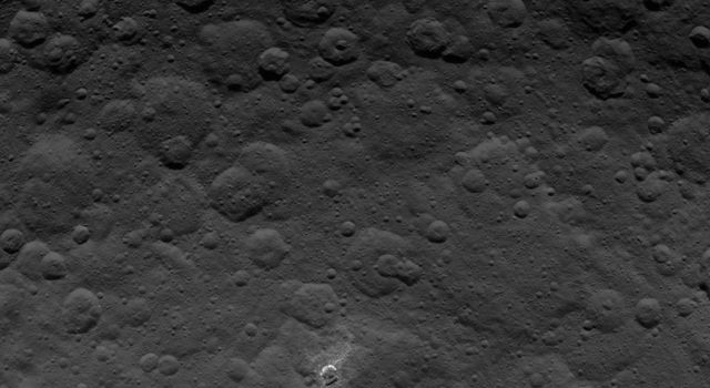 This image, taken by NASA's Dawn spacecraft, shows dwarf planet Ceres from an altitude of 2,700 miles (4,400 kilometers). The image, with a resolution of 1,400 feet (410 meters) per pixel, was taken on June 21, 2015.
