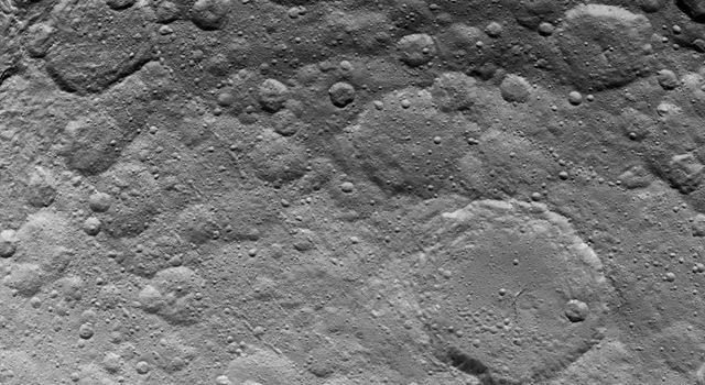 This image, taken by NASA's Dawn spacecraft, shows a portion of the northern hemisphere on dwarf planet Ceres on June 24, 2015. The largest crater in this image, in the lower right quadrant, is called Ezinu. It is 75 miles (120 kilometers) across.