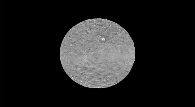 This frame from a video shows the bright spots in Occator crater on dwarf planet Ceres, generated from data from NASA's Dawn spacecraft.
