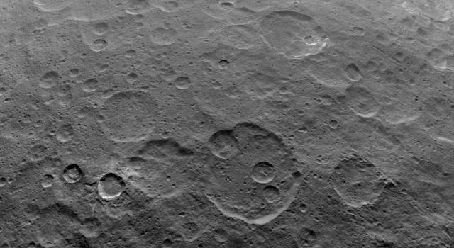 This image, taken on June 7, 2015 by NASA's Dawn spacecraft, shows a portion of the southern hemisphere of Ceres from an altitude of 2,700 miles (4,400 kilometers). The crater at the lower left is called Toharu, which is 54 miles (87 kilometers) wide.