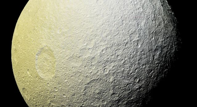This enhanced-color mosaic from NASA's Cassini spacecraft of Saturn's icy moon Tethys shows a range of features on the moon's trailing hemisphere.