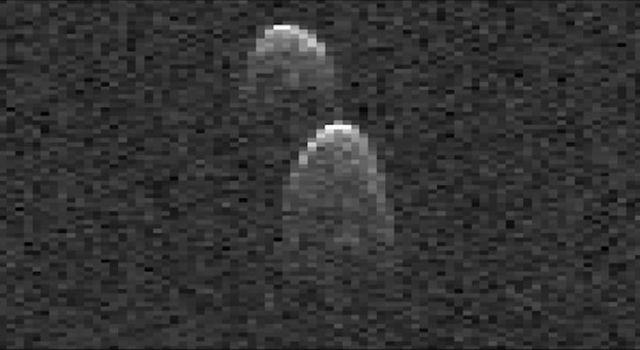 This frame from a movie made from radar images of asteroid 1999 JD6, obtained on July 25, 2015. The asteroid is approximately 1.2 miles (2 kilometers) on its long axis.