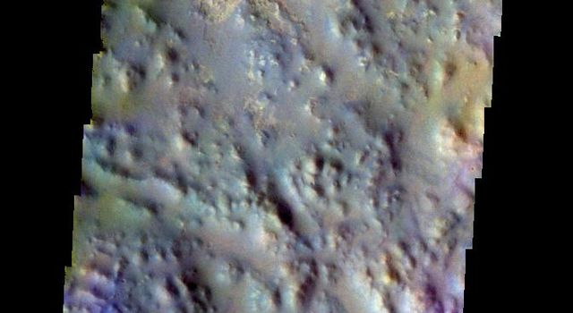 The THEMIS VIS camera contains 5 filters. The data from different filters can be combined in multiple ways to create a false color image. This false color image from NASA's 2001 Mars Odyssey spacecraft shows part of Iani Chaos.