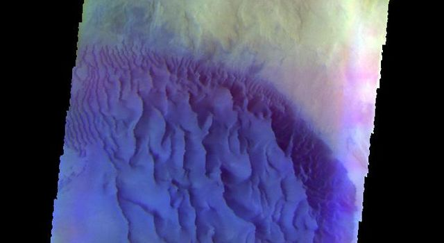 The THEMIS VIS camera contains 5 filters. Data from different filters can be combined in many ways to create a false color image. This image from NASA's 2001 Mars Odyssey spacecraft shows a sand sheet with surface dune forms in an unnamed crater.