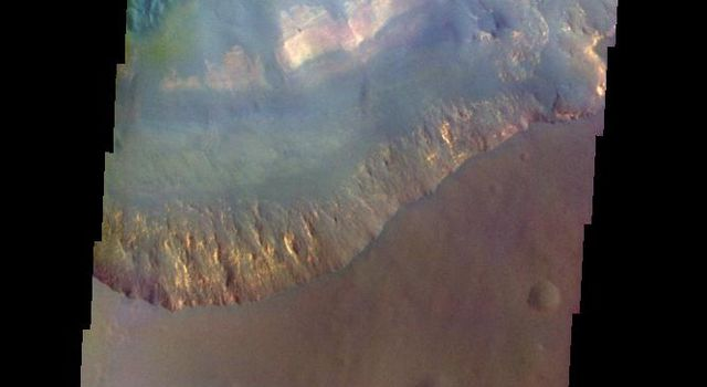 The THEMIS VIS camera contains 5 filters. The data from different filters can be combined in multiple ways to create a false color image. This image from NASA's 2001 Mars Odyssey spacecraft shows part of Capri Mensa and Capri Chasma.