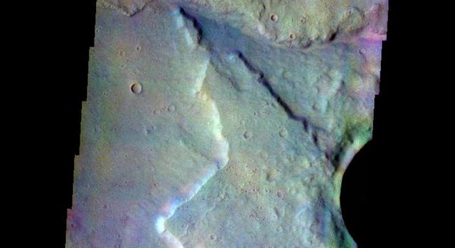 The THEMIS VIS camera contains 5 filters. The data from different filters can be combined in multiple many ways to create a false color image. This image from NASA's 2001 Mars Odyssey spacecraft shows the edge of the northwestern flank of Tyrrhenus Mons.