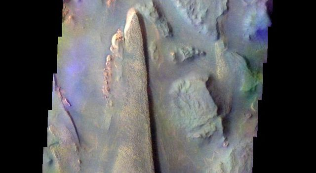 The THEMIS VIS camera contains 5 filters. The data from different filters can be combined in multiple many ways to create a false color image. This image from NASA's 2001 Mars Odyssey spacecraft shows part of Aureum Chaos.