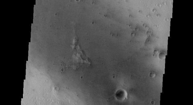 This image captured by NASA's 2001 Mars Odyssey spacecraft shows part of the floor of Gusev Crater, home of the MER Spirit Rover.