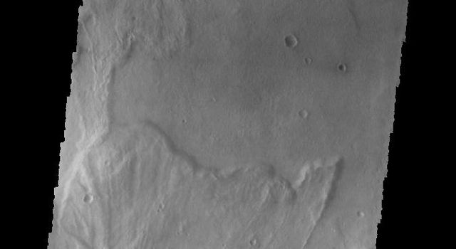 This unnamed crater in Terra Sirenum shows crater ejecta, as captured in this image by NASA's 2001 Mars Odyssey spacecraft.