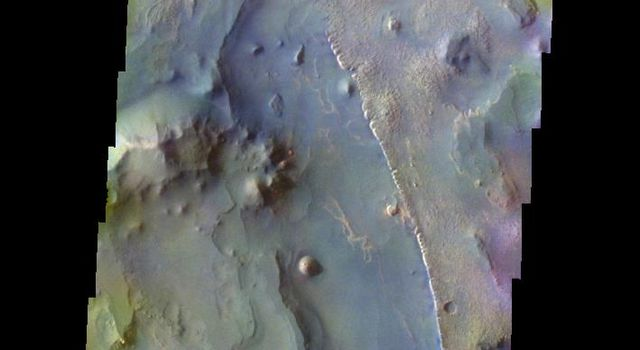 The THEMIS VIS camera contains 5 filters. The data from different filters can be combined in multiple ways to create a false color image. This image from NASA's 2001 Mars Odyssey spacecraft shows part of Aureum Chaos.