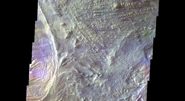 The THEMIS VIS camera contains 5 filters. The data from different filters can be combined in multiple ways to create a false color image. This image from NASA's 2001 Mars Odyssey spacecraft shows part of the floor of Candor Chasma.