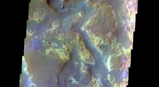 The THEMIS VIS camera contains 5 filters. The data from different filters can be combined in multiple ways to create a false color image. This image from NASA's 2001 Mars Odyssey spacecraft shows where Mawrth Vallis empties into Chryse Planitia.