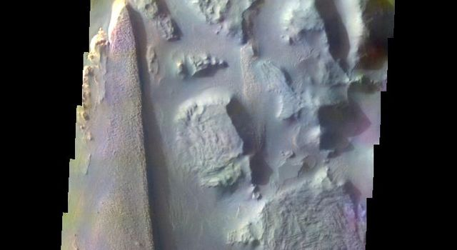 The THEMIS VIS camera contains 5 filters. The data from different filters can be combined in multiple ways to create a false color image. This image from NASA's 2001 Mars Odyssey spacecraft shows part part of Aureum Chaos.