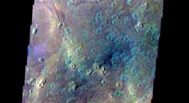 The THEMIS VIS camera contains 5 filters. The data from different filters can be combined in multiple ways to create a false color image. This image from NASA's 2001 Mars Odyssey spacecraft shows part part of Acidalia Planitia.