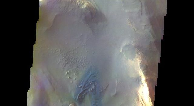 The THEMIS VIS camera contains 5 filters. The data from different filters can be combined in multiple ways to create a false color image. This image from NASA's 2001 Mars Odyssey spacecraft shows part of the floor of Melas Chasma.