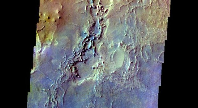 The THEMIS VIS camera contains 5 filters. The data from different filters can be combined in multiple ways to create a false color image. This image from NASA's 2001 Mars Odyssey spacecraft shows part of Arabia Terra.