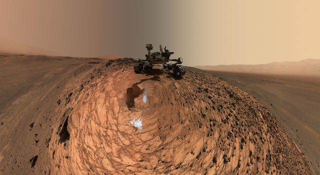 This low-angle self-portrait of NASA's Curiosity Mars rover shows the vehicle above the 'Buckskin' rock target, where the mission collected its seventh drilled sample. The site is in the 'Marias Pass' area of lower Mount Sharp.