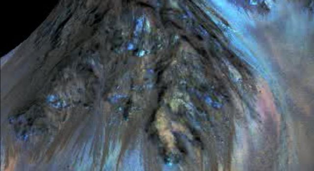 This frame from an animation simulates a fly-around look at one of the places on Mars where dark streaks advance down slopes during warm seasons, possibly involving liquid water. This image is from NASA's Mars Reconnaissance Orbiter.