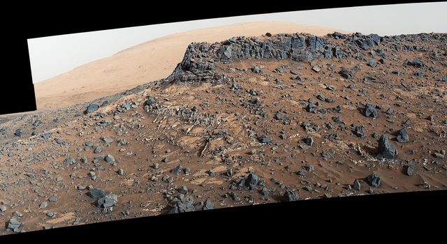 This view from the Mast Camera (Mastcam) on NASA's Curiosity Mars rover shows a site with a network of prominent mineral veins below a cap rock ridge on lower Mount Sharp.
