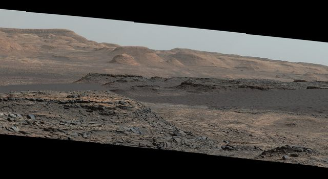 This view from the Mast Camera (Mastcam) on NASA's Curiosity Mars rover shows a dark sand dune in the middle distance. Mount Sharp will be the first in-place study of an active sand dune anywhere other than Earth.