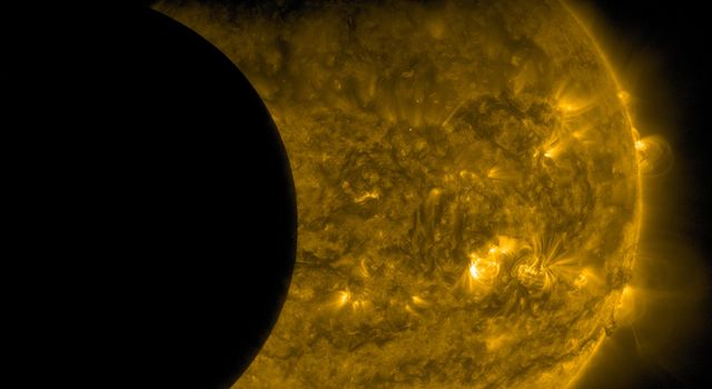 On Sept. 13, 2015, as NASA's Solar Dynamics Observatory, or SDO, kept up its constant watch on the sun. Just as the moon came into SDO's field of view on a path to cross the sun, Earth entered the picture, blocking SDO's view completely.