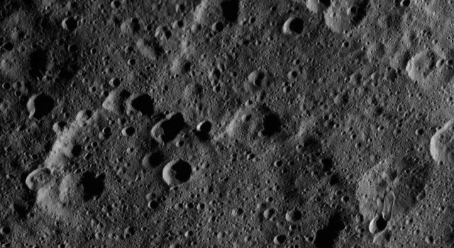 This image, taken by NASA's Dawn spacecraft, shows the surface of dwarf planet Ceres from an altitude of 915 miles (1,470 kilometers). The image was taken on September 20, 2015, and has a resolution of 450 feet (140 meters) per pixel.