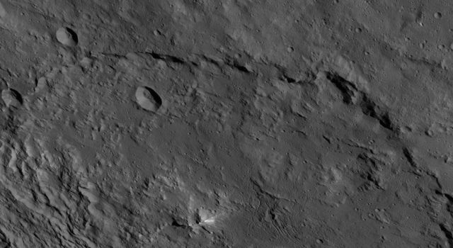 This image, taken by NASA's Dawn spacecraft, shows a portion of the southern hemisphere of dwarf planet Ceres from an altitude of 915 miles (1,470 kilometers). Urvara crater, named for the Indian and Iranian deity of plants and fields, is featured.