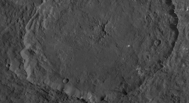 This image, taken by NASA's Dawn spacecraft, shows a portion of the northern hemisphere of dwarf planet Ceres from an altitude of 915 miles (1,470 kilometers). Featured here is Dantu crater, named for the Ghanan god associated with the planting of corn.