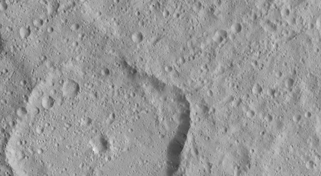 Numerous linear crater chains on Ceres dominate this image from NASA's Dawn spacecraft, which is centered at approximately 20 degrees north latitude, 198 degrees east longitude.