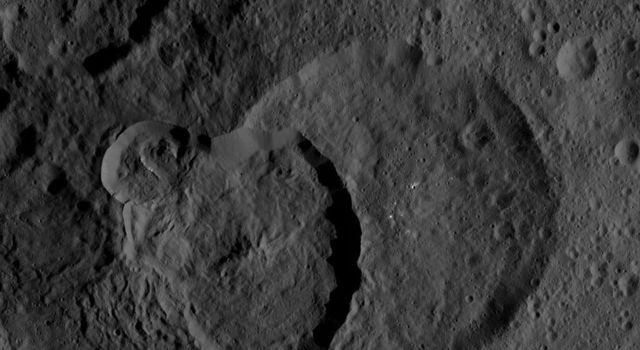 The largest feature in this image from NASA's Dawn spacecraft is Geshtin crater, which is superposed (located on top of) by the younger Datan crater. On its upper-left rim, Datan is superposed by a smaller, even younger unnamed crater.