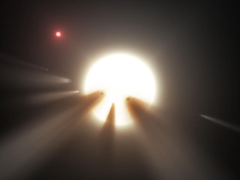 Esta ilustración de artista muestra una estrella detrás de un cometa fragmentado.