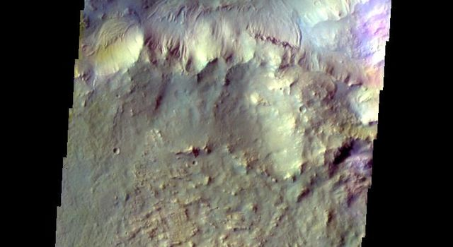 The THEMIS VIS camera contains 5 filters. The data from different filters can be combined in multiple ways to create a false color image. This image from NASA's 2001 Mars Odyssey spacecraft shows small dunes on the floor of Bamberg Crater.