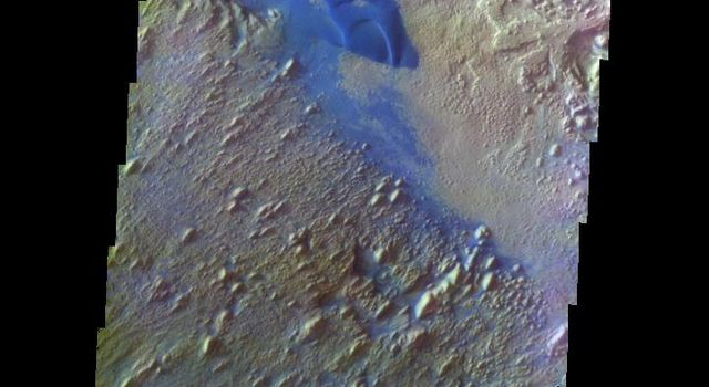 The THEMIS VIS camera contains 5 filters. The data from different filters can be combined in multiple ways to create a false color image. This image from NASA's 2001 Mars Odyssey spacecraft shows part of the floor of Danielson Crater.