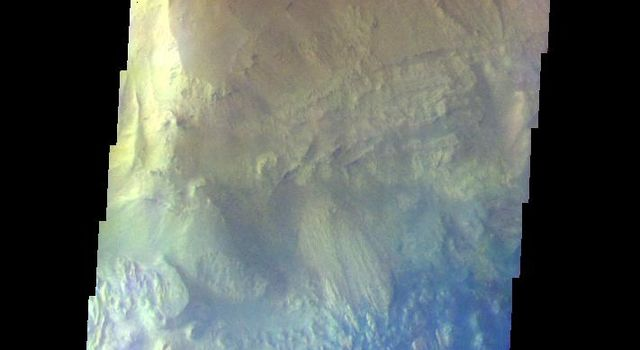 The THEMIS VIS camera contains 5 filters. The data from different filters can be combined in multiple ways to create a false color image. This image from NASA's 2001 Mars Odyssey spacecraft shows part of of Hebes Chasma.