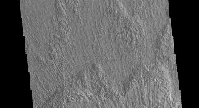 This image captured by NASA's 2001 Mars Odyssey spacecraft show part of the ejecta of Bacolor Crater. The ejecta is layered and grooved, all radial to the crater itself. Bacolor Crater is located in Utopia Planitia.