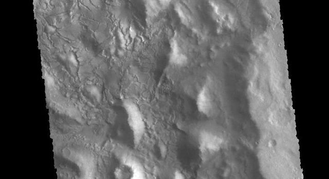 This image captured by NASA's 2001 Mars Odyssey spacecraft shows part of the interior of an unnamed crater in Arabia Terra.